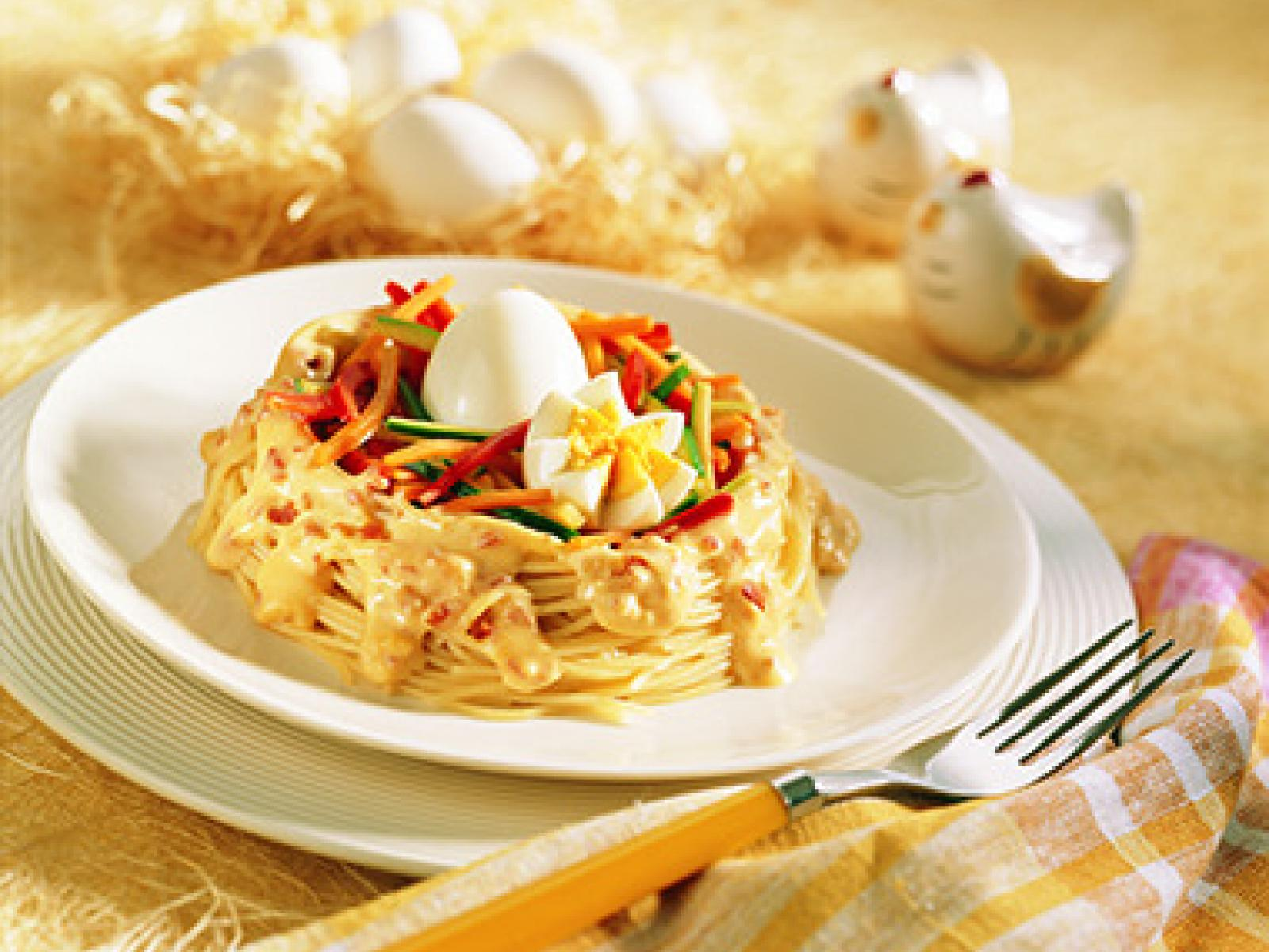 Eggs in Pasta Nests with Cheese Sauce